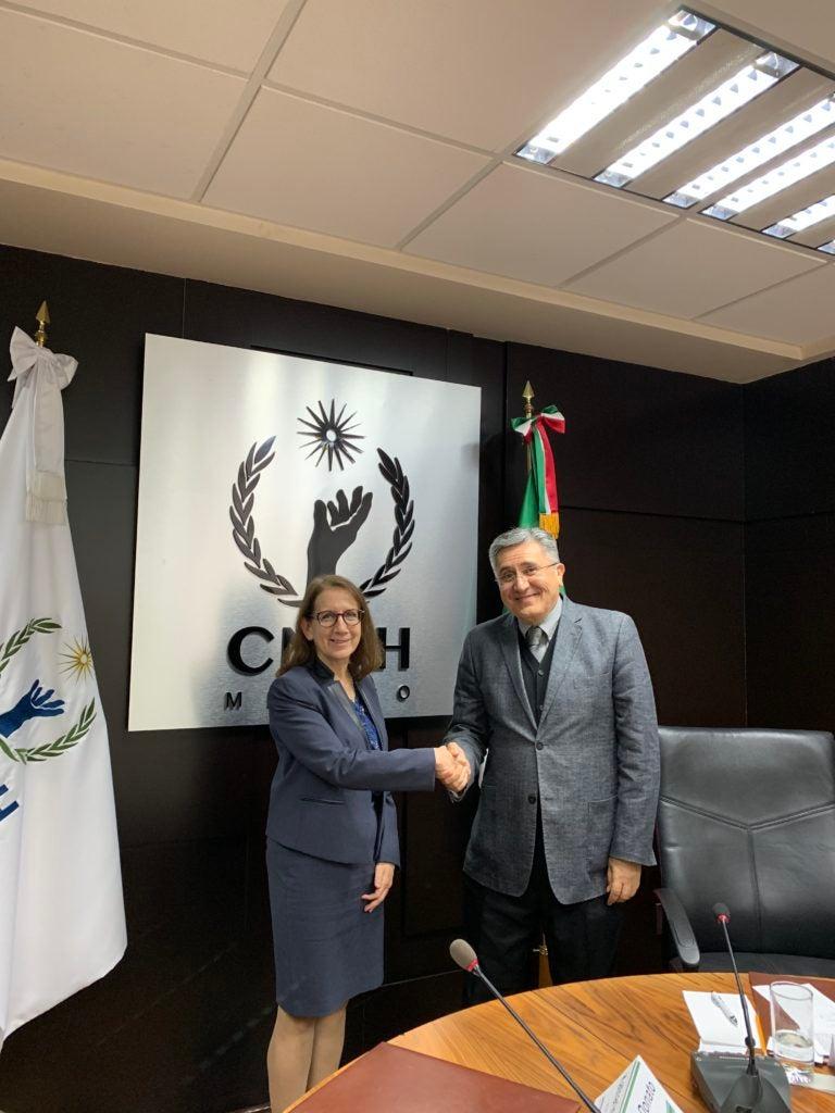 Katharine Donato and CNDH President Luis Raúl González Pérez